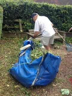 image of man clearing weeds