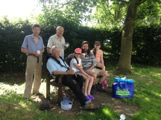 image of Garston Gang sitting on the bench with refreshments
