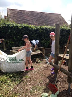 image of young helpers clearing the playground